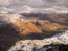 Late afternoon sun lights up Little Langdale viewed from Wetherlam