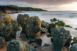 Rock formations at sunset on Whistling Sands on the Lleyn Peninsula