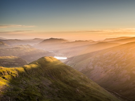 The just risen sun casts heavenly rays across the valley and lights up Middle Dodd