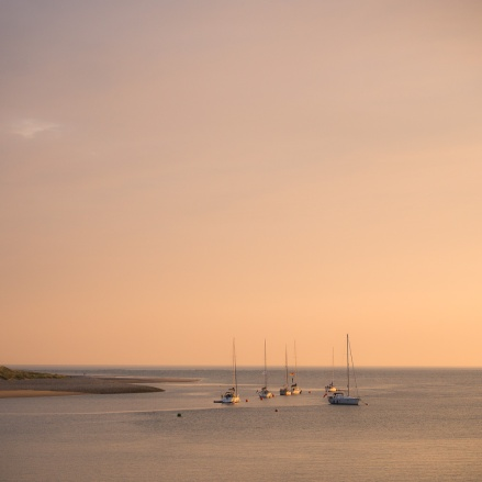 Small boats at anchor in the Mawddach Estuary at sunset
