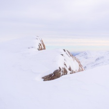 A close-up of snow-covered rocks near Bowfell summit