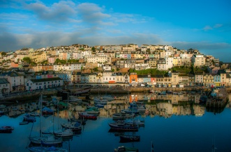 Sunrise paints the Devon port of Brixham in Mediterranean colours