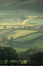 Winter sun on a cosy farmhouse in Wharfedale