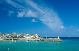 A smear of thin cloud seems to rise from the harbour lighthouse in St Ives