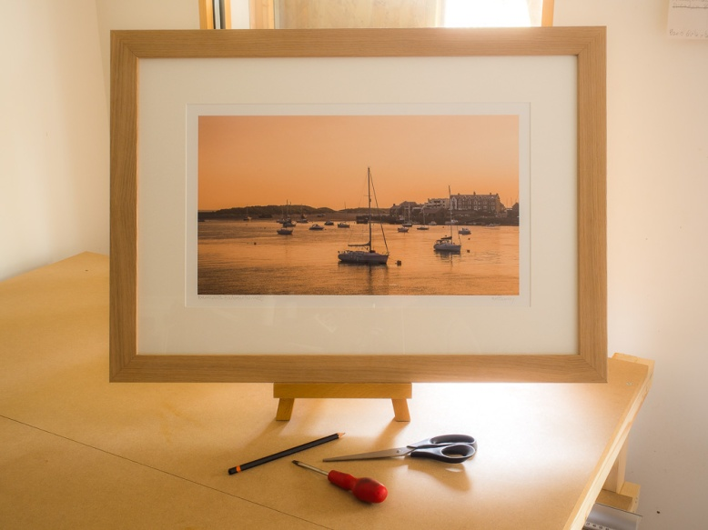 A large size framed print in the Oak finish frame