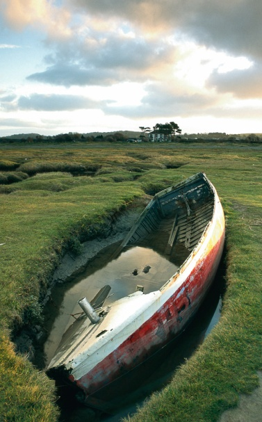 A long abandoned rowing boat found in the salt grass land of the Silverdale coast
