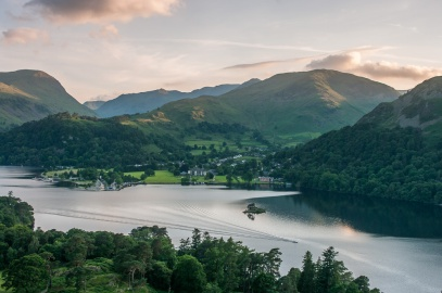 Birkhouse Moor and the Helvellyn range tower over Ullswater at dawn
